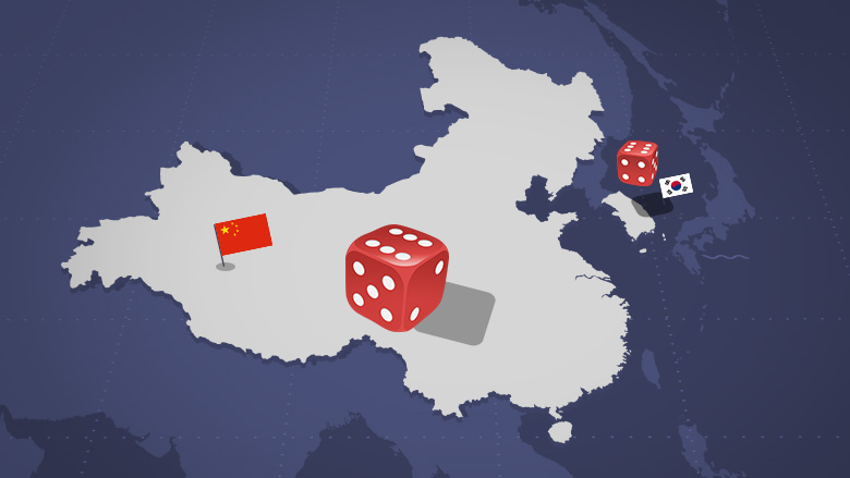 China and South Korea with craps dice bouncing between them