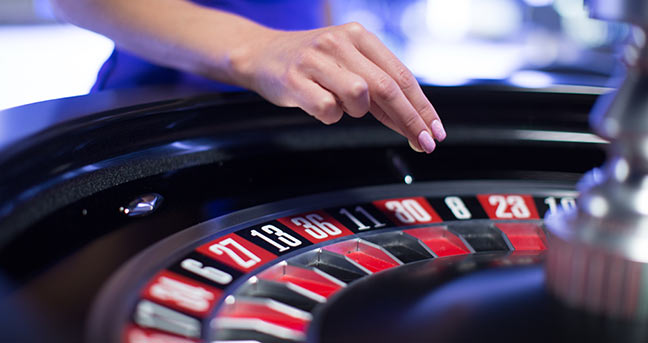 Roulette Wheel and the dealer hand with the roulette ball